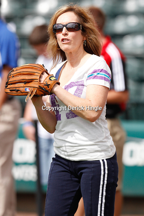 March 5, 2011; Lake Buena Vista, FL, USA; ESPN reporter Linda Cohn plays catch before a spring training exhibition game against the Atlanta Braves at Disney Wide World of Sports complex.  Mandatory Credit: Derick E. Hingle