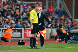 An annoyed looking Stoke City Manager Mark Hughes shouts at the linesman - Photo mandatory by-line: Rogan Thomson/JMP - 07966 386802 - 01/01/2015 - SPORT - FOOTBALL - Stoke-on-Trent, England - Britannia Stadium - Stoke City v Manchester United - New Year's Day Football - Barclays Premier League.