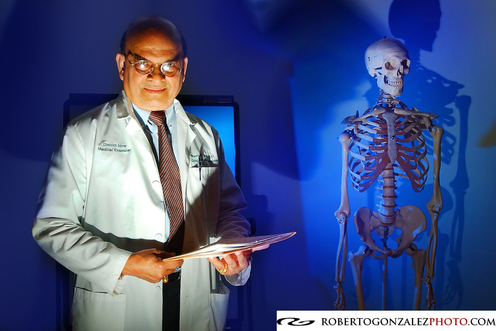 Medical examiner doctor Shashi Gore with a skeleton in his office.