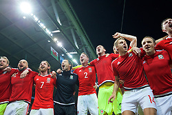 LILLE, FRANCE - Friday, July 1, 2016: Wales players celebrate in the team huddle following a 3-1 victory over Belgium and reaching the Semi-Final during the UEFA Euro 2016 Championship Quarter-Final match at the Stade Pierre Mauroy. Ashley 'Jazz' Richards, Joe Allen, head of performance Ryland Morgans, Chris Gunter, goalkeeper Daniel Ward, David Edwards, David Vaughan. (Pic by David Rawcliffe/Propaganda)