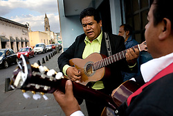 Jaime Alfredo Luevano and his mariachi band play music in downtown Aguascalientes.