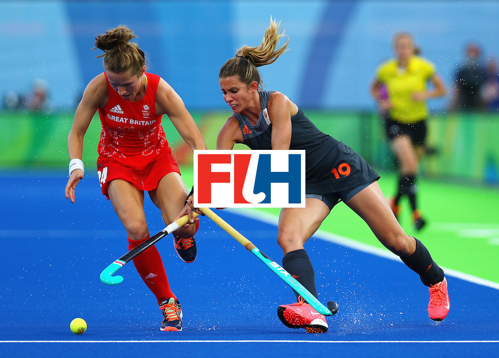RIO DE JANEIRO, BRAZIL - AUGUST 19:  Shona McCallin of Great Britain and Ellen Hoog of Netherlands action during the Women's Gold Medal Match against the Netherlands on Day 14 of the Rio 2016 Olympic Games at the Olympic Hockey Centre on August 19, 2016 in Rio de Janeiro, Brazil.  (Photo by Tom Pennington/Getty Images)