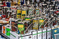Decorative olive oil cans or dispensers on display at Campo de Fiori outdoor market in Rome, where shoppers may taste olive oil samples among other things, and also purchase gifts and souvenirs.