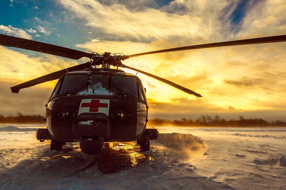 HH-60 MEDEVAC Blackhawk with C Company 3-10 GSAB sits ready to respond as the sun rises and during a Lake Effect Storm Warning