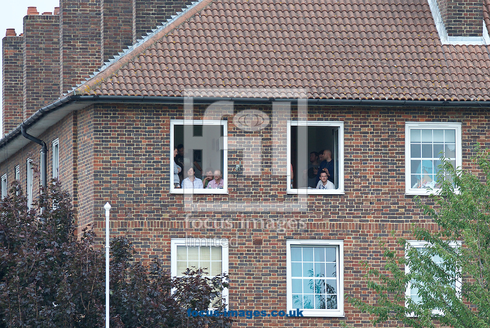 The local residence have a great view of the cricket during the 5th Investec Ashes Test Match match at the Kia Oval, London<br /> Picture by Alan Stanford/Focus Images Ltd +44 7915 056117<br /> 20/08/2015