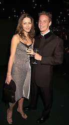 F1 driver JENSON BUTTON and MISS LOUISE GRIFFITHS, at a dinner in London on 24th October 2000.OID 38