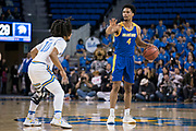 San Jose State Spartans guard Zach Chappell (4) directs the offense while UCLA Bruins guard Tyger Campbell (10) defends during an NCAA college basketball game, Sunday, Dec. 1, 2019, in Los Angeles. UCLA defeated San Jose State 93-64. (Jon Endow/Image of Sport)