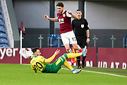 Norwich City forward Josip Drmić (20) tackle Burnley midfielder Robbie Brady (12) during the The FA Cup match between Burnley and Norwich City at Turf Moor, Burnley, England on 25 January 2020.