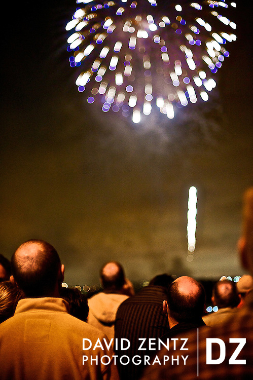 A group of bald men watch fireworks in Marina Del Rey, Calif, on July 4, 2010.