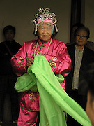 elderly Chinese woman in traditional dress and headpiece