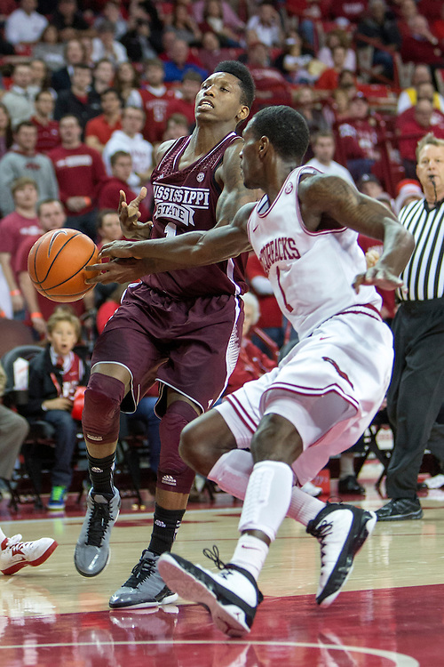 FAYETTEVILLE, AR - JANUARY 23:  Fred Thomas #1 of the Mississippi State Bulldogs has the ball hit out of his hands by Mardracus Wade #1 of the Arkansas Razorbacks at Bud Walton Arena on January 23, 2013 in Fayetteville, Arkansas. The Razorbacks defeated the Bulldogs 96-70.  (Photo by Wesley Hitt/Getty Images) *** Local Caption *** Fred Thomas; Mardracus Wade