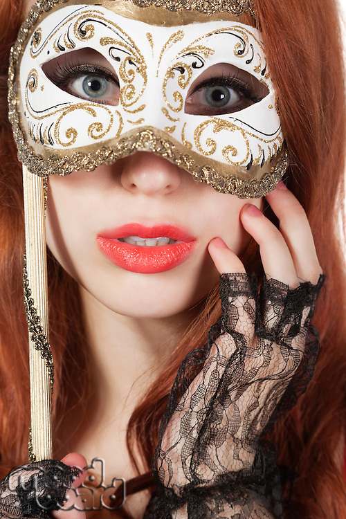 Portrait of young woman with eye mask