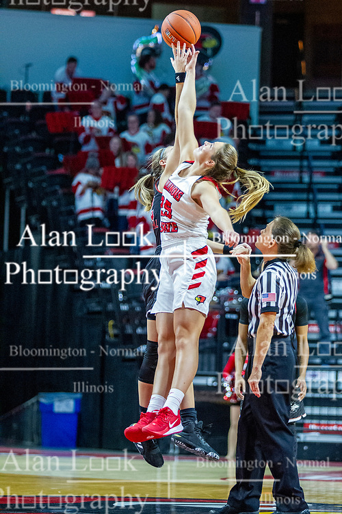 NORMAL, IL - November 20:  Referee Molly Caldwell tosses the tip off for Lexi Wallen during a college women's basketball game between the ISU Redbirds and the Huskies of Northern Illinois November 20 2019 at Redbird Arena in Normal, IL. (Photo by Alan Look)