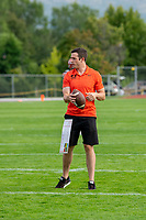 KELOWNA, BC - AUGUST 17:  A coach stands on the field during pre-game warm up against the Westshore Rebels at the Apple Bowl on August 17, 2019 in Kelowna, Canada. (Photo by Marissa Baecker/Shoot the Breeze)