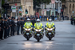 © Licensed to London News Pictures. 14/10/2019. Oxford, UK. Thames Valley Police officer's riding motorcycles move along the High Street in Oxford city centre ahead of the funeral of PC Andrew Harper. Photo credit: Peter Manning/LNP