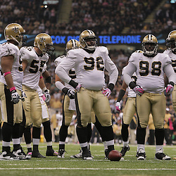 2009 October 04: New Orleans Saints defensive players wait at the line during the first half of a week four regular season game between the New Orleans Saints and the New York Jets at the Louisiana Superdome in New Orleans, Louisiana.