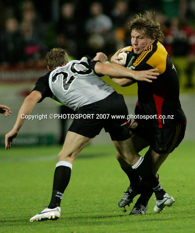 The Chiefs' Aled del Malmanche breaks the tackle of the Sharks' Butch James during the Super 14 rugby union match between the Chiefs and Sharks at Waikato Stadium, Hamilton, New Zealand on Saturday 21 April 2007. The Chiefs won the match 35 - 27. Photo: Hagen Hopkins/PHOTOSPORT<br /><br /><br /><br />210407