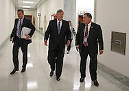 Agriculture Secretary Tom Vilsack talks to his staff as he walks down the hallway to testify before the House Appropriations Agriculture subcommittee on the USDA's fiscal 2014 budget proposal in the Rayburn House Office Building in Washington, DC on Tuesday, April 16, 2013.
