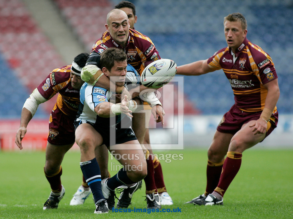 Huddersfield - Sunday, June 22nd, 2008: Harlequin's Louie McCarthy-Scarsbrook in action against Huddersfield's Andy Raleigh and Jamahl Lolesi during the Engage Super League match at the Galpharm Stadium, Huddersfield. (Pic by Michael Sedgwick/Focus Images)