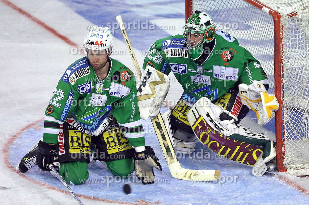 Greg Kuznik of Olimpija and Klemen Mohoric of Olimpija at ice hockey match ZM Olimpija vs  Acroni Jesencie in third round of final of Slovenian National Championship,  on April 8, 2008 in Arena Tivoli, Ljubljana, Slovenia. Acroni Jesenice won the game 1:2 and lead the series 3:0.  (Photo by Vid Ponikvar / Sportal Images)