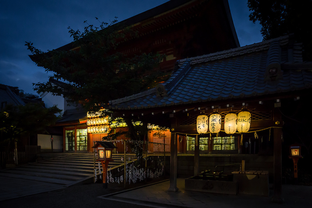 Night has fallen in Kyoto, and the lanterns of Yasaka Shrine are lit.