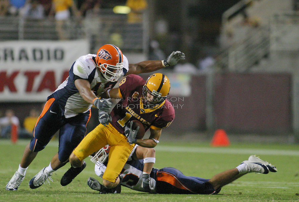 Tempe,AZ - 09-02-04- ASU Sundevils' T.Richardson is tackled by  R.Rodriguez in the second  half of their season opener aginst UTEP. Richardson had 5 catches for 70 yards in the 41-9 win. Ross Mason photo