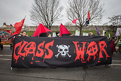 © Licensed to London News Pictures . 08/03/2014 . York , UK . Class War banner at the march . A TUC protest march against the Liberal Democrat and Conservative coalition government passes by the Barbican Centre in York . The second day of the Liberal Democrat Spring Conference today (Saturday 8th March 2014) . Photo credit : Joel Goodman/LNP