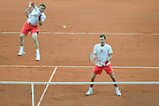 (L) Marcin Matkowski &amp; (R) Mariusz Fyrstenberg both from Poland in ation while men's double during the BNP Paribas Davis Cup 2013 between Poland and Australia at Torwar Hall in Warsaw on September 14, 2013.<br /> <br /> Poland, Warsaw, September 14, 2013<br /> <br /> Picture also available in RAW (NEF) or TIFF format on special request.<br /> <br /> For editorial use only. Any commercial or promotional use requires permission.<br /> <br /> Photo by &copy; Adam Nurkiewicz / Mediasport
