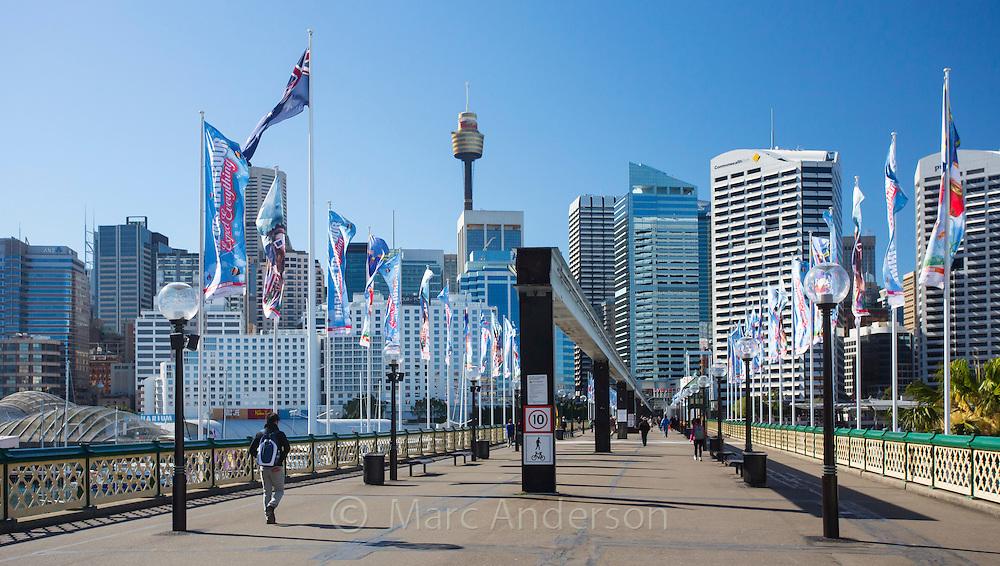People walking along a promenade in Darling Harbour near Sydney CBD, Sydney, New South Wales, Australia