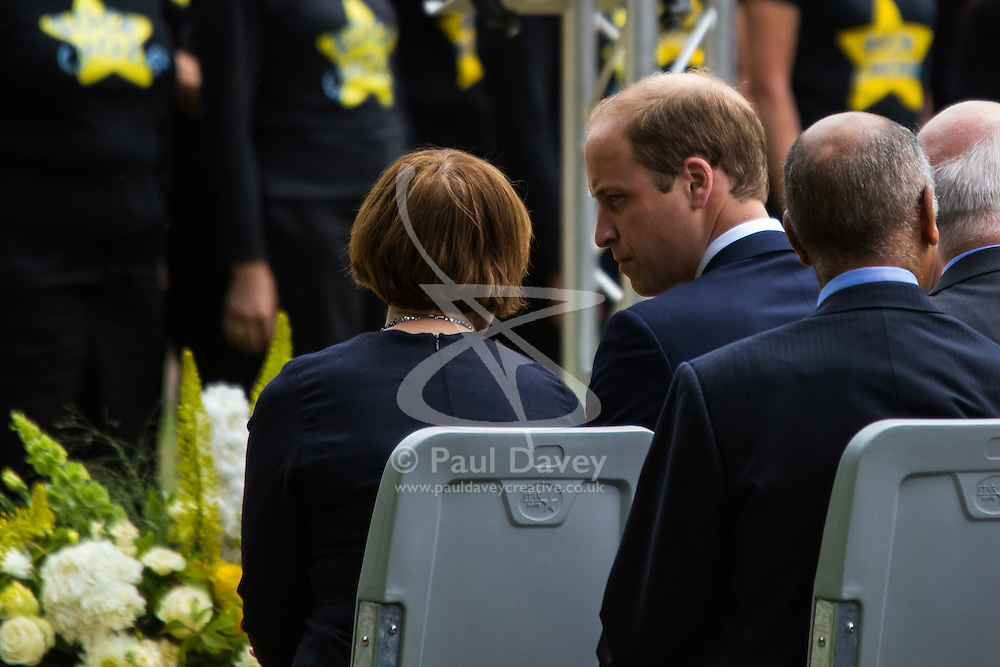 Hyde Park, London, July 7th 2015. Families of the victims and survivors of the 7/7 bombings in London gather at Hyde Park and are joined by the Duke of Cambridge Prince William at an emotional service commemorqating the Islamist terrorist bombing outrage that happened on London's transport network, claiming 57 lives and left scores of people injured. PICTURED: Prince William talks with Tessa Jowell.