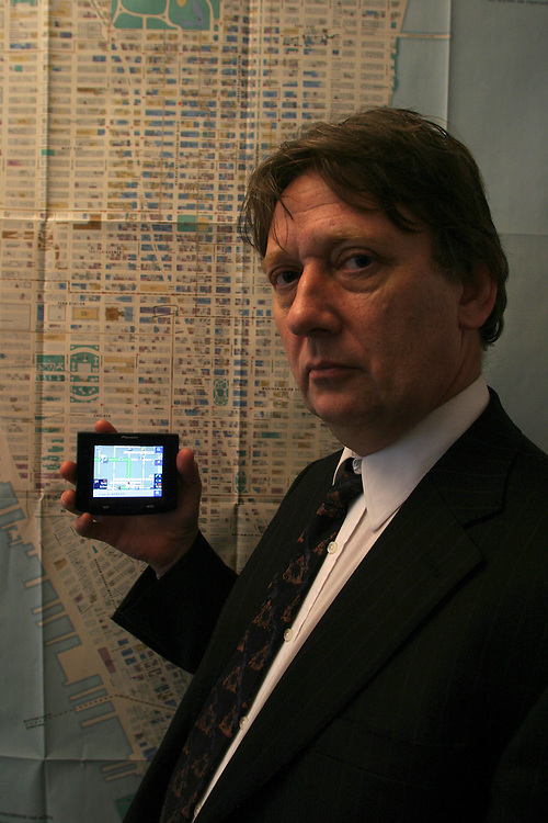 Paul Taylor reporter for the Financial holds a New navigator system Pioneer AVIC-S1 next to the map of Manhattan Island. In the office of the Financial Times in New York on  Thursday  February 14 2007.....