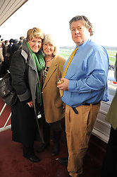 Left to right, CLARE BALDING, JILLY COOPER and FELIX COOPER at the 2012 Hennessy Gold Cup at Newbury Racecourse, Berkshire on 1st December 2012