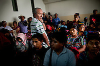 Members of the Maya- Achí indigenous community from Rabinal, in northern Guatemala, watch court proceedings of five former members of right-wing Guatemalan paramilitaries sentenced to 7,710 years for participating in the Plan de Sanchez 1982 massacre of 268 Maya-Achí, at the Supreme Court of Justice, in Guatemala City, on Tuesday, March 20, 2012. Nearly a quarter of a million people were killed in Guatemala's civil war which ran from 1960 to 1996.