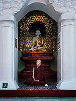 YANGON, MYANMAR - CIRCA DECEMBER 2017: Monk meditating at the Shwedagon Pagoda in Yangon