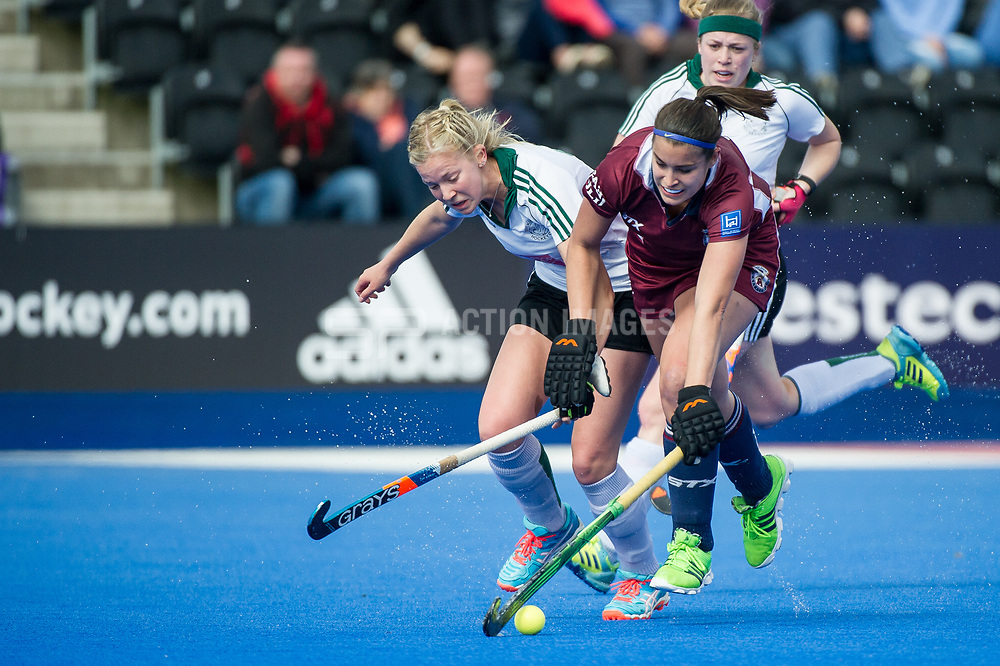 Wimbledon's Libby Sherriff is tackled by Lottie Porter of Buckingham. Wimbledon v Buckingham - Investec Women's Hockey League Finals, Lee Valley Hockey & Tennis Centre, London, UK on 23 April 2017. Photo: Simon Parker