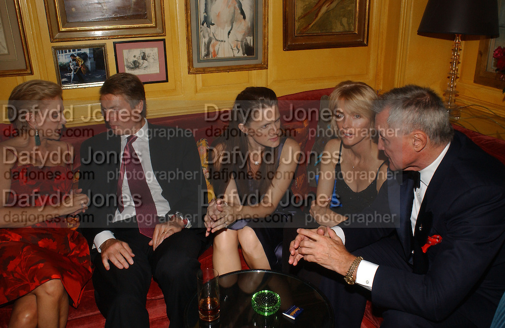 Carolina Herrera, Richard Johnson and his wife Sasha, Chuck Pfeiffer, Party given by Taki and Alexandra Theodorakopoulos. Annabels. London. 26 September 2006. -DO NOT ARCHIVE-© Copyright Photograph by Dafydd Jones 66 Stockwell Park Rd. London SW9 0DA Tel 020 7733 0108 www.dafjones.com