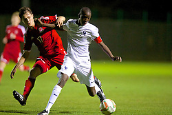 NEWPORT, WALES - Thursday, September 25, 2014: Wales' Liam Cullen in action against France's captain Mahamadou Dembele during the Under-16's International Friendly match at Dragon Park. (Pic by David Rawcliffe/Propaganda)