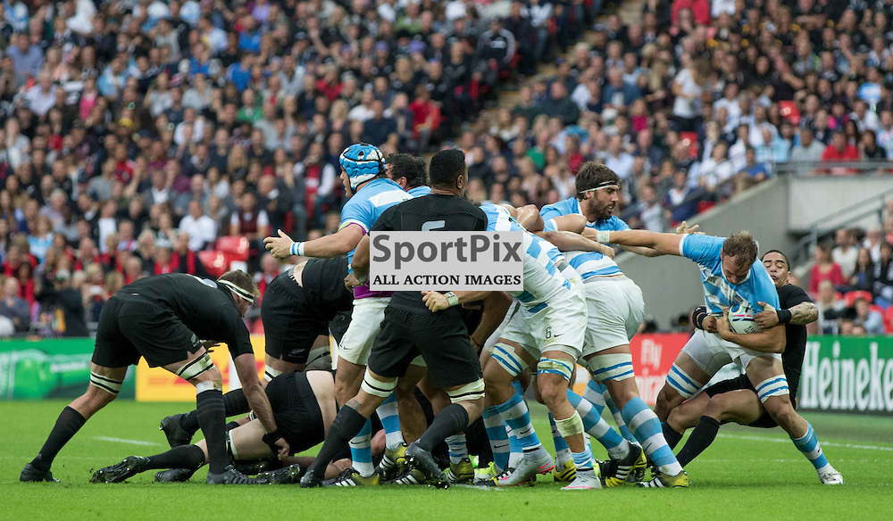 Aaron Smith tackes during the Rugby World Cup New Zealand v Argentina, Sunday 20 September 2015, Wembley Stadium (Photo by Mike Poole)