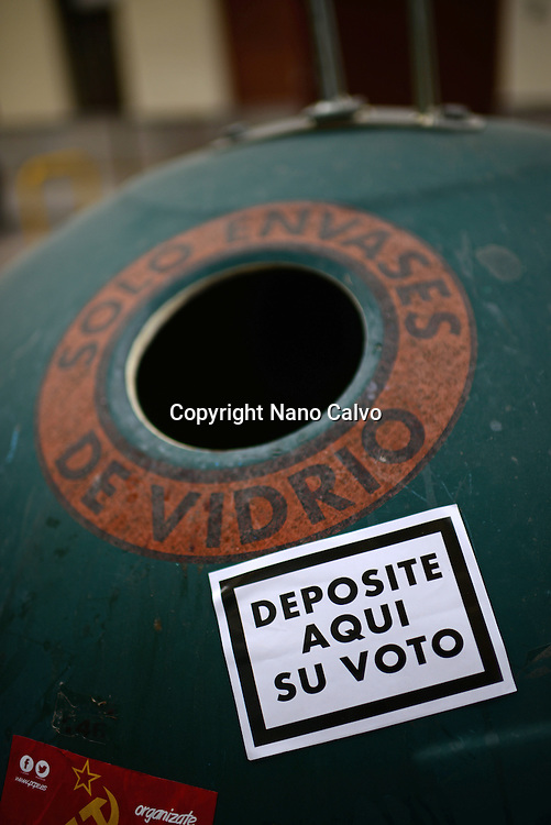 """Sticker reads """"Deposit your vote here"""" on recycle trash."""