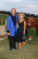 MIKE & ANGIE RUTHERFORD at the Cowdray Gold Cup Golden Jubilee Ball held at Cowdray Park Polo Club, on 21st July 2006.<br />