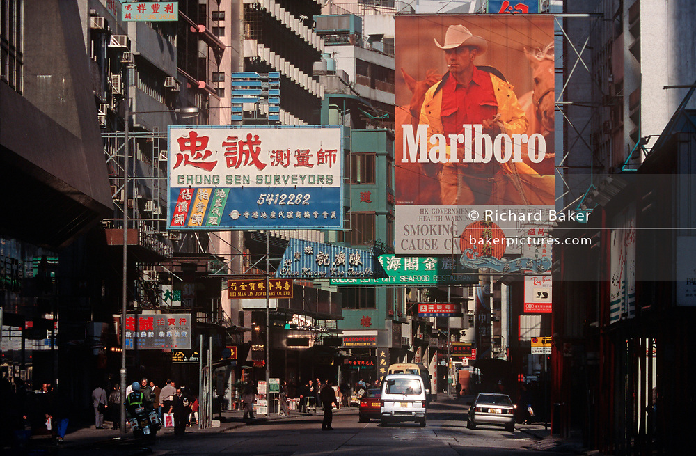While still a British colony, 1990s street advertising including one for the cigarette Marlboro Man, on 21st April 1995, in Kowloon, Hong Kong, China. (Photo by Richard Baker / In Pictures via Getty Images)