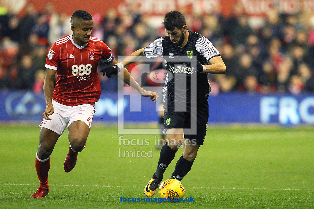 Michael Mancienne of Nottingham Forest and Nelson Oliveira of Norwich in action during the Sky Bet Championship match at the City Ground, Nottingham<br /> Picture by Paul Chesterton/Focus Images Ltd +44 7904 640267<br /> 21/11/2017