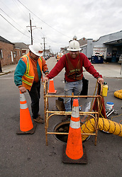 16 January, 2005.  New Orleans, Louisiana.<br /> Workmen continue to empty the drains of debris in the Marigny neighbourhood. <br /> Photo; Charlie Varley/varleypix.com