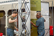 Circulation Supervisor of Milpitas Robert Bright, left, and Maintenance Mechanic Gary Ponce, right, set up the Smithsonian Institution's traveling Exploring Human Origins exhibit at the Milpitas Library in Milpitas, California, on November 24, 2015. (Stan Olszewski/SOSKIphoto)