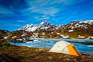 Tent camping at half frozen Lost Lake. Resurrection Peaks in the background. Chugach National Forest, Kenai Peninsula, Alaska