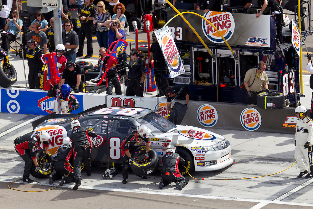 LAS VEGAS, NV - MAR 11, 2012:  Landon Cassill (83) brings his car in for service during the Kobalt Tools 400 race at the Las Vegas Motor Speedway in Las Vegas, NV.