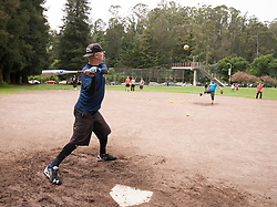 Aaron Axelsen, left, takes his turn in the batter's box during batting practice, as the Montclair softball league celebrates its 50th season, Saturday, April 22, 2017, at Montclair Park in Oakland, Calif. The pickup softball game, played every Saturday by a group of enthusiasts ranging in age from 20 to 75, started in 1968 in Berkeley and moved to Montclair about 25 years ago. (Photo by D. Ross Cameron)