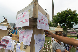 © Licensed to London News Pictures. 27/05/2014. Anti-Protestor stick antimilitary signs at the gates of Victory monument during a Anti-Coup protest in Bangkok Thailand. yesterday Thailand's King formally approved Thai army chief General Prayut Chan-O-Cha as head of the nation's new military junta.  Photo credit : Asanka Brendon Ratnayake/LNP