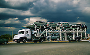 New automobile transportation by truck in Brazil; automobile manufacturing is an important industry in Brazil.