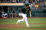 Oakland Athletics shortstop Marcus Semien (10) runs to first base after hitting against the San Francisco Giants at Oakland Coliseum in Oakland, California, on August 1, 2017. (Stan Olszewski/Special to S.F. Examiner)